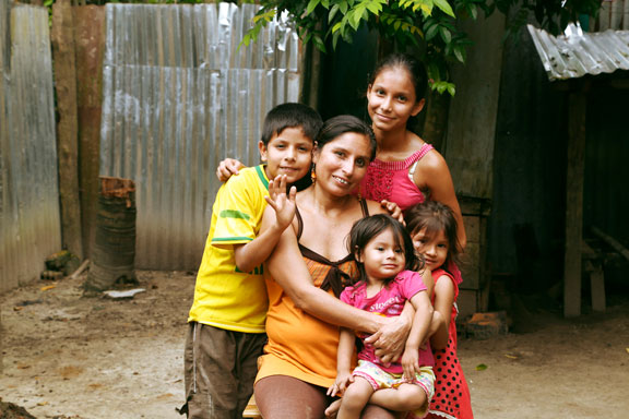 indigenous family in Loreto, who is part of the minga project embracing each other