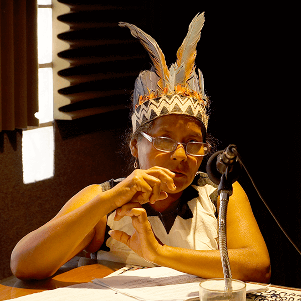 "Indigenous woman speaking on the minga radio ""welcome health"""